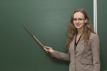Teacher is pointing to something on the board