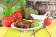 Piece of fried meat on plate on wooden table close-up