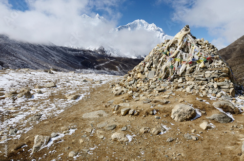Stone cairn with religious tibetan flags,Everest region,Nepal