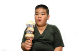 Hungry obese fat boy child with Many bread