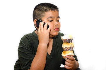 Fat boy talking via cell phone while eating bread