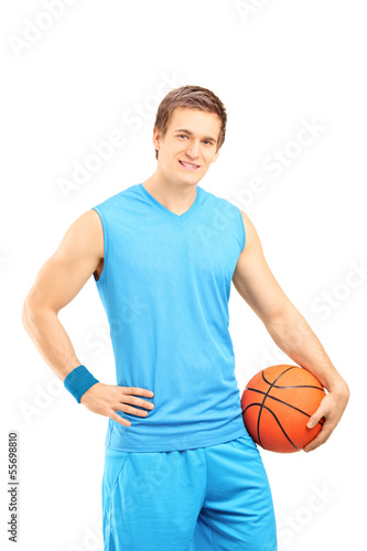Basketball player holding a ball and looking at a camera