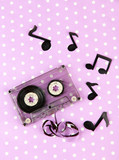 Old cassette on purple background