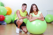 Girl and guy in fitness room