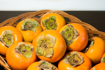Persimmons on the rattan tray