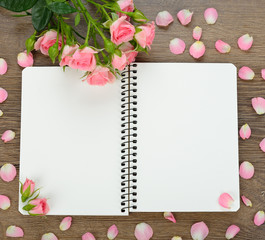Notebook and roses