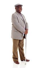 elderly african man holding walking cane
