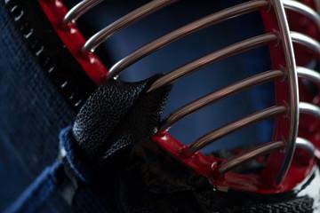 Fragment of kendo helmet, close-up, horizontal shot
