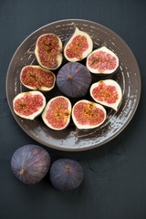 Ripe fig fruits on a plate, view from above
