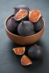 Ceramic bowl with ripe figs, vertical shot