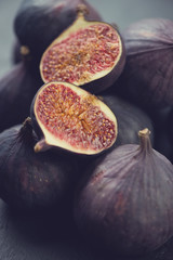 Close-up of ripe fig fruits, vertical shot
