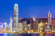 Hong Kong city skyline at night with Victoria Harbor and skyscra