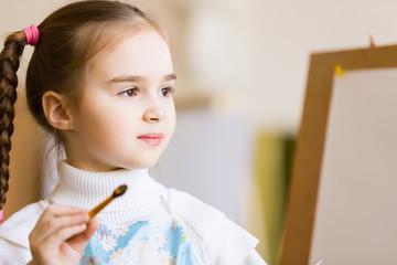 Cute girl painting
