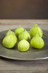 green fresh figs in a plate