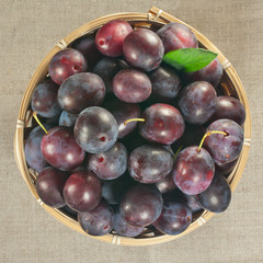 ripe plums in a basket