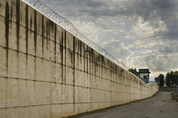 Prison wall in cloudy day.