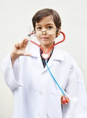 Little boy pretending to be a doctor