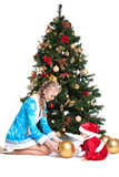 Snow Maiden and baby-Santa with Christmas tree