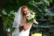 Beautiful red hair bride wearing wedding dress