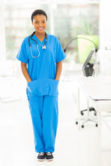 young african nurse standing in modern office