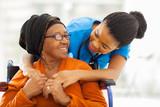 african senior patient with female nurse - 55712895