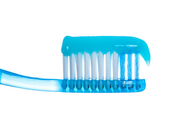 One toothbrush with toothpaste over white background
