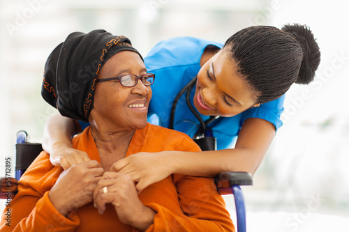 canvas print picture african senior patient with female nurse
