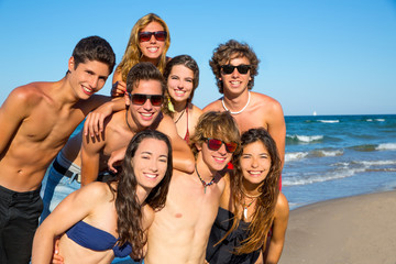 Happy teenagers young group together on beach
