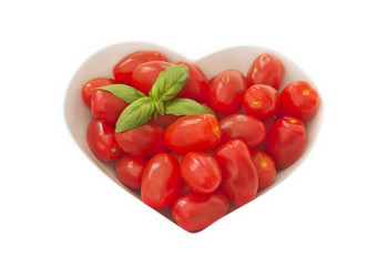 Baby plum tomates in a heart shaped bowl