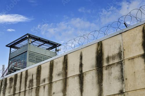 Leinwanddruck Bild The prison wall.