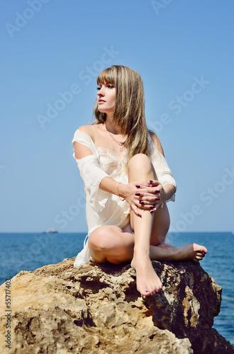 woman sitting near sea