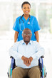 african health care worker and senior patient