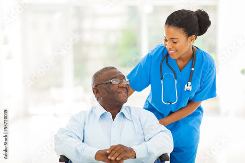 african nurse taking care of senior patient in wheelchair - 55720049