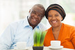 cute senior african couple at home