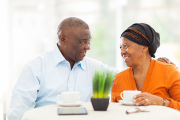 senior african couple relaxing at home