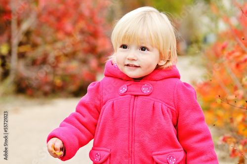 baby girl walking in fall park