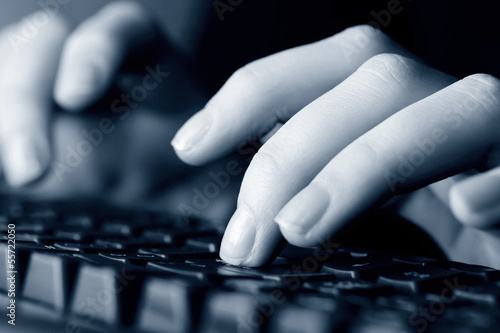 Female hands typing on computer keyboard