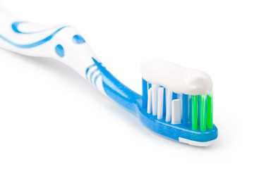 Toothbrush with toothpaste, on a white background