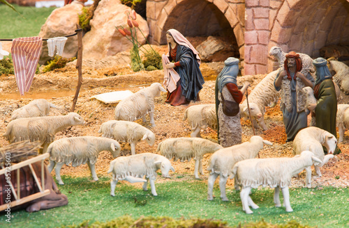 Shepherds with a herd of sheep