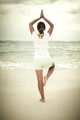Woman doing yoga on Punta Cana beach.