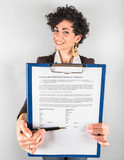 Young Businesswoman Showing a Contract to Sign