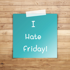 I hate friday on sticky paper on Brown wood plank wall texture b