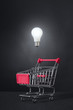 shone electric bulb and shopping trolley