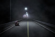 Troubled teenager with hidden face sitting in the night street