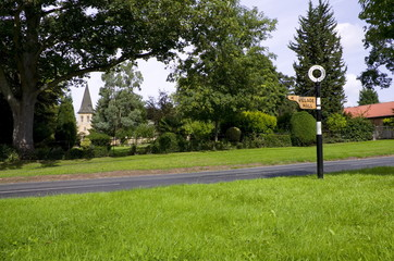 Early English Road Sign and Village green