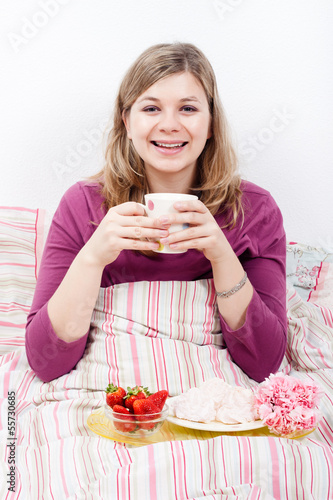 Happy beautiful woman with cup of coffee