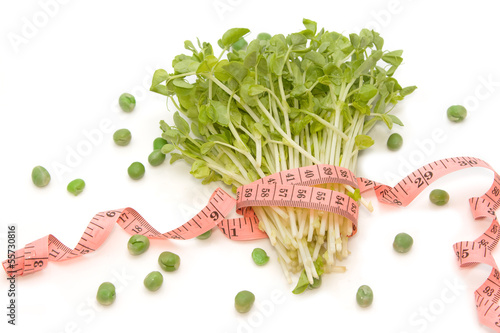 Snow Pea Sprouts with measuring tape (dieting concept)
