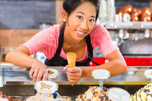 Female seller in Parlor with ice cream cone
