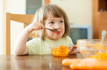 child eating carrot salad