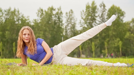 Woman exercising in a meadow, Sports Outdoor Activities